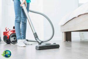 woman vacuuming bedroom