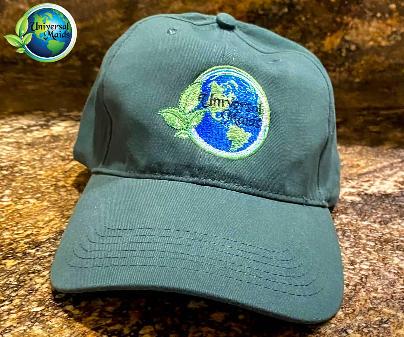 A hat with Universalmaids logo