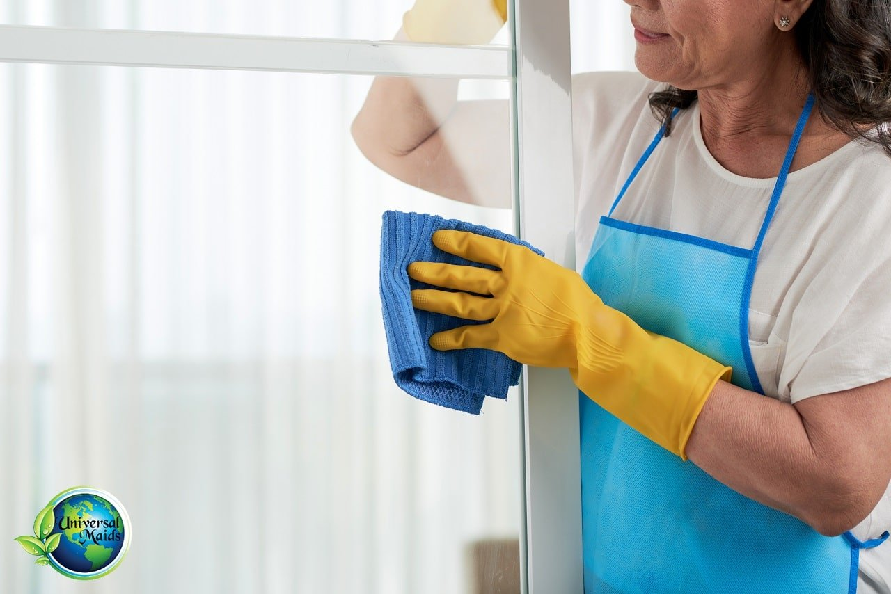 A maid is cleaning the window