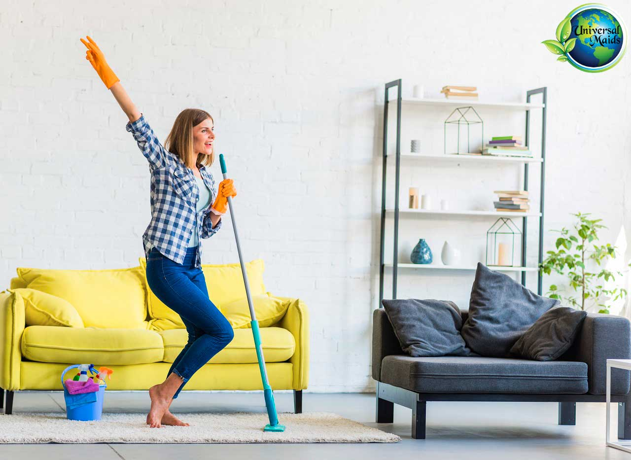 A woman is doing fun cleaning