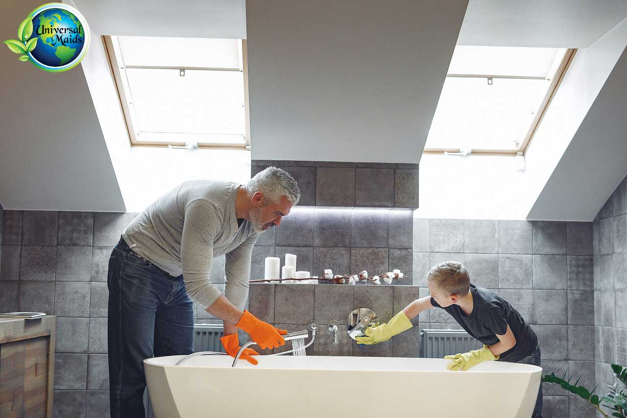 A father and his son are cleaning the bathroom