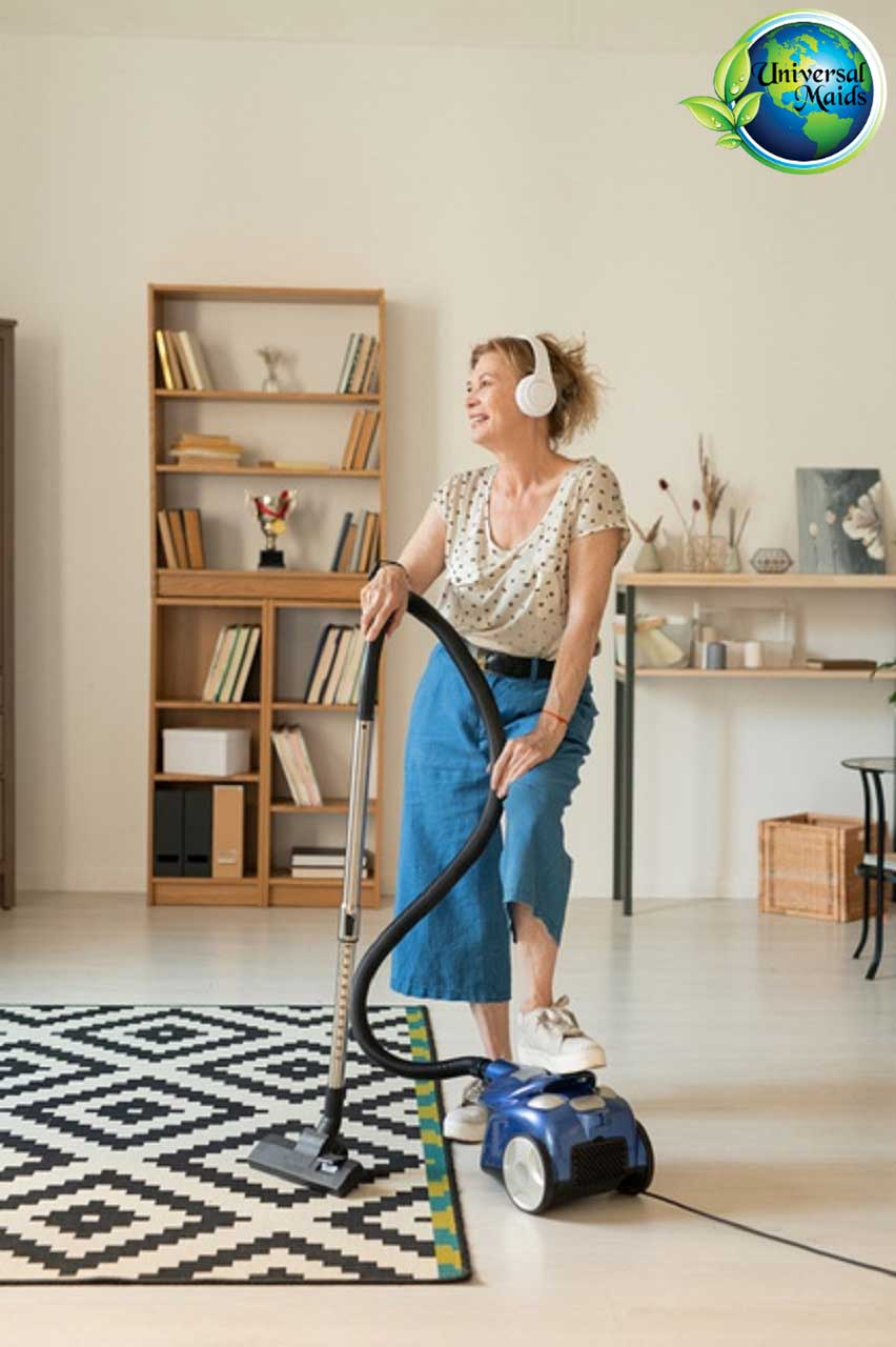 A woman is listening to music when cleaning