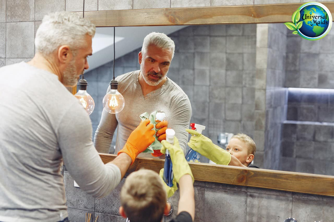 A man and boy cleaning the mirror